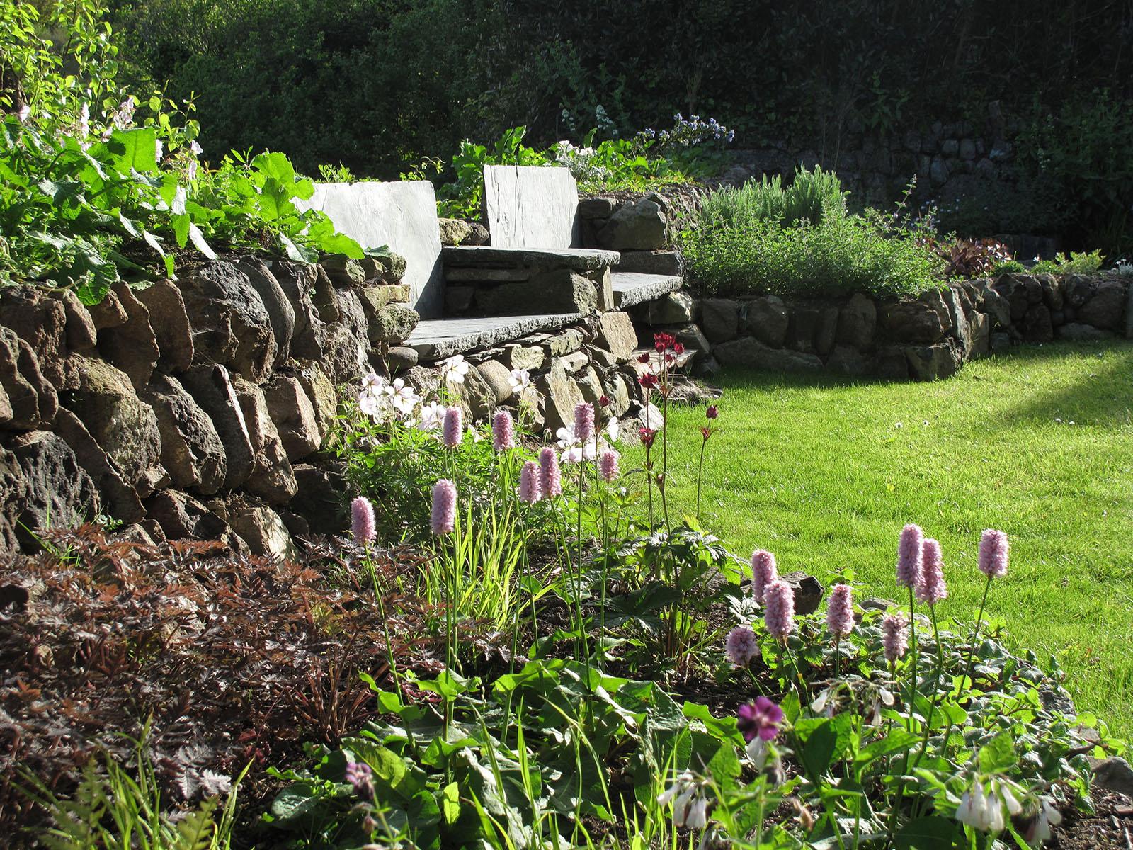 Slate setting set into Cornish hedge